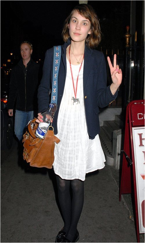 Alexa Chung and her Mulberry Roxanne Bag with a guitar strap