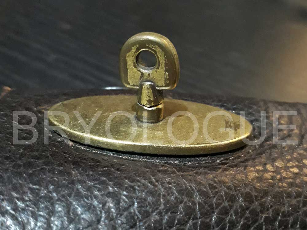 Profile shot of an authentic Mulberry postman's lock from a leather messenger bag