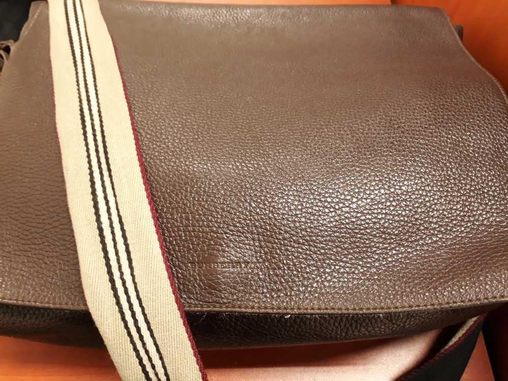 Five years after, the leather is holding up fine in this Burberry leather messenger bag