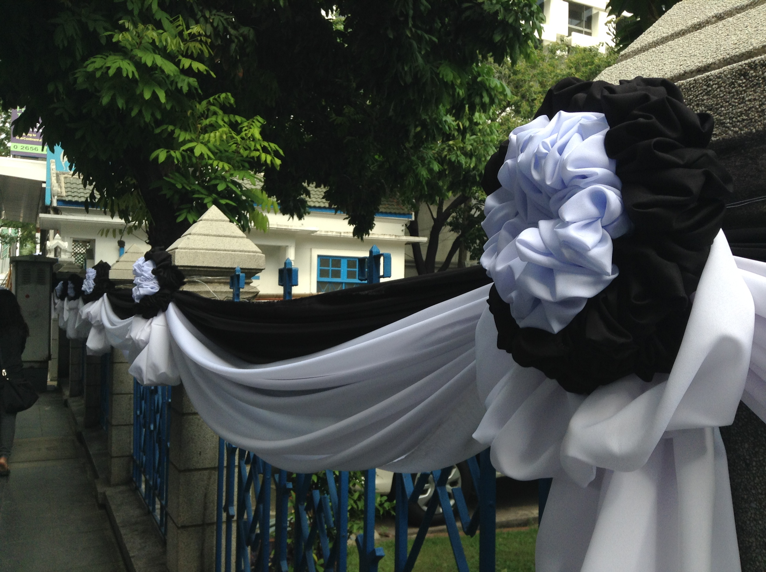 Black and white fabric draped outside buildings