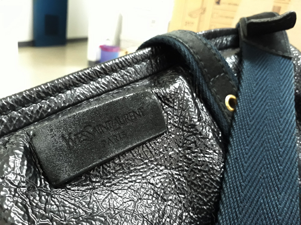 Details of the Yves Saint Laurent Odeon Crushed Patent Bag YSL