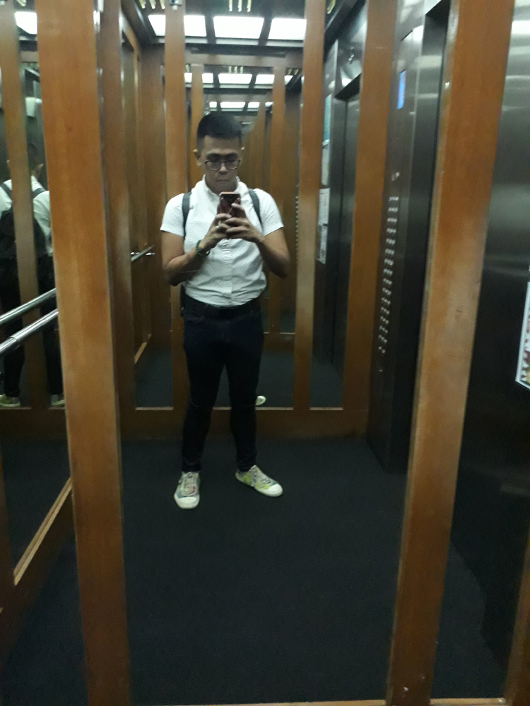 First day at work! Back to wearing jeans! - Uniqlo white button-down shirt, Penshoppe jeans, Comme des Garcons PLAY multicolor sneakers, Prada nylon backpack